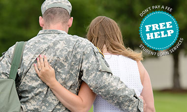 Close-up of a servicemember and his wife, walking hand in hand. A sign advising 'Free Help. Don't pay a fee for student loan services.' is in the photo.